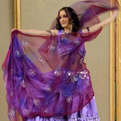 Learn to bellydance while balancing on top of glasses!(yep, you read that right)