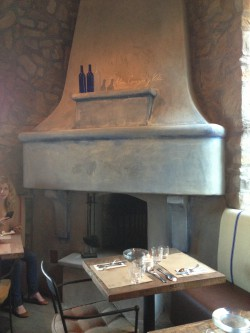 "The working fireplace (with the saying ""alma, corazón y vita"" written on it) is fired up in the colder months."