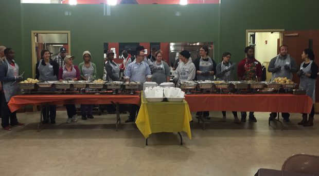 Volunteers getting ready to serve the annual Thanksgiving-Eve dinner